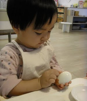 Concentration on peeling an egg